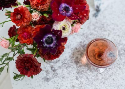 red, burgundy, pink flower centerpiece shot at honeypot los angeles venue